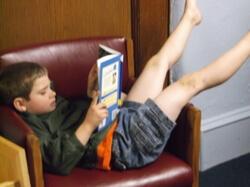 A boy reading a book.