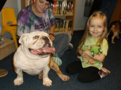 Bulldog and girl.