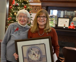 Virginia and Colene hold the picture donated by Nancy for the raffle.