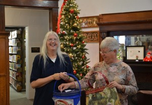 Lora and Wendy draw for the winner of the bag donated by Wendy.