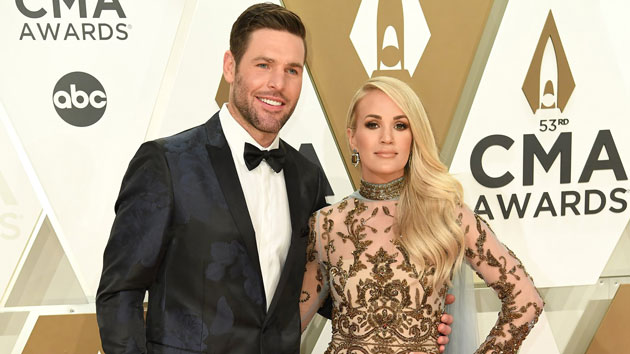 """Carrie Underwood says it's """"good to be back"""" at Nashville Predators game with husband Mike Fisher"""