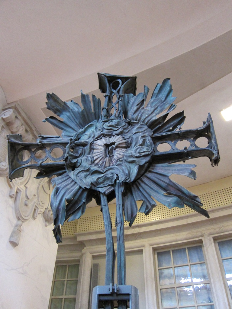 The cross that used to top the lantern on the dome, stripped of its plating.