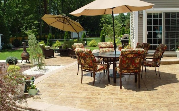 Stamped Concrete Patio with a Retaining Wall
