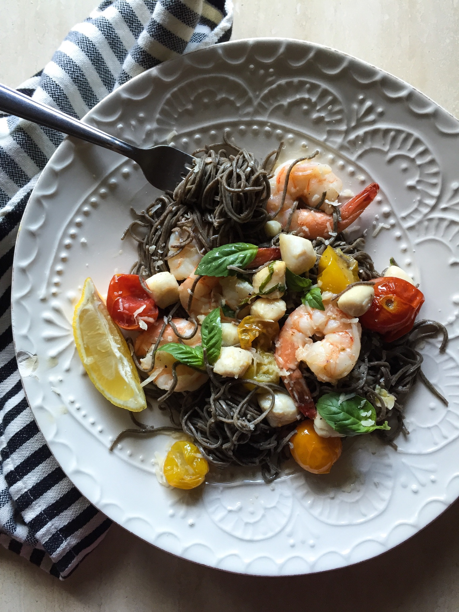 Seafood Black Bean Pasta with Roasted Tomatoes in Garlic Truffle Sauce