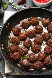 Beef and Bulgur Meatballs in Pomegranate Sauce | dishingouthealth.com