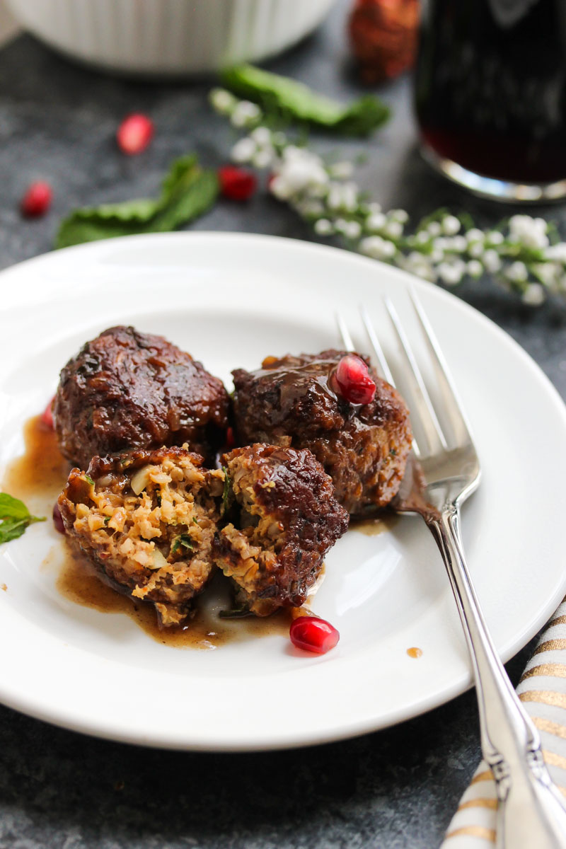 Beef and Bulgur Meatballs in Pomegranate Sauce | dishingouthealth.com