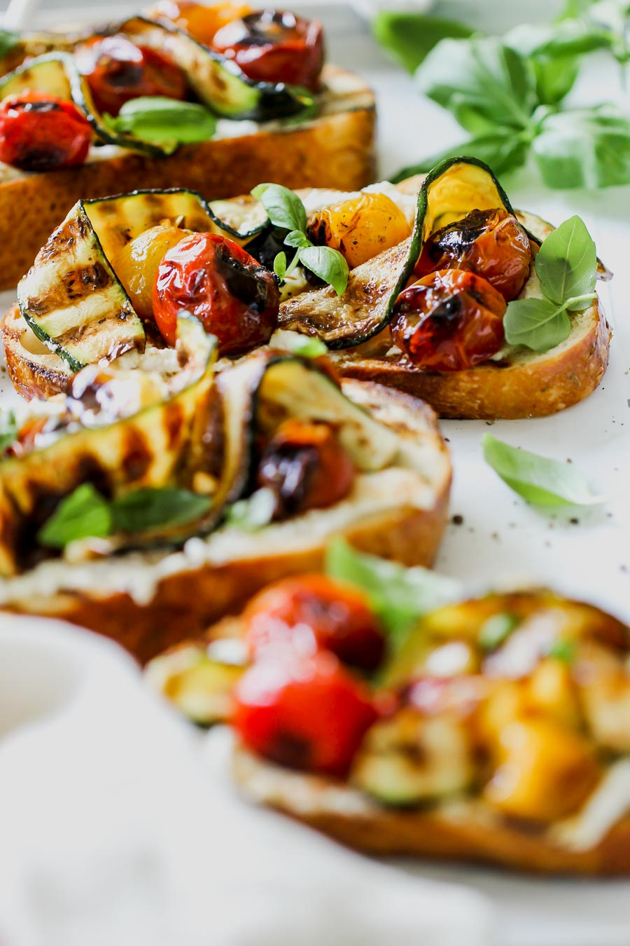 Blistered Tomato and Zucchini Tartines with Whipped Feta