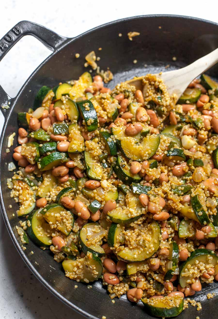 Sautéed vegetables, quinoa, and pinto beans