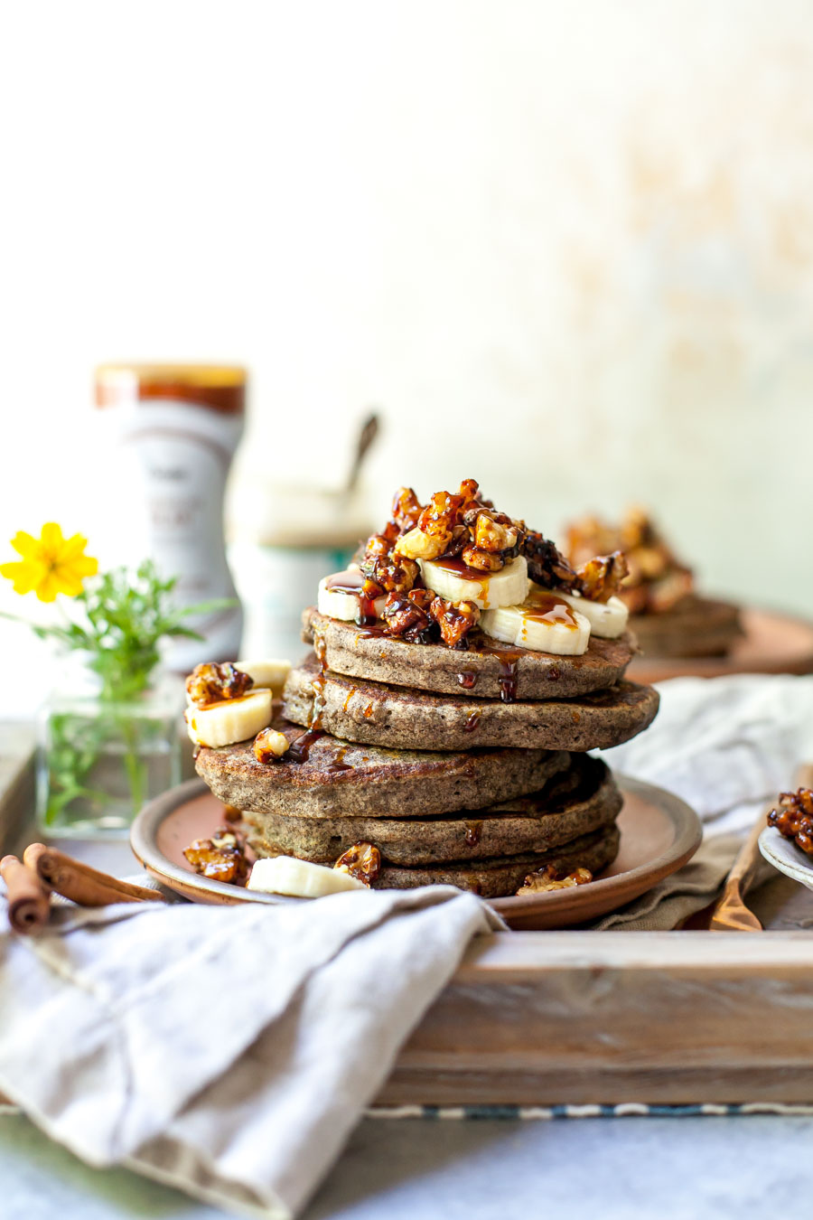 Banana Bread Pancakes made with Buckwheat Flour and Topped with Stovetop Candied Walnuts