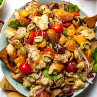 Summer Panzanella Salad with tomatoes, olives, and a Bloody Mary-inspired dressing