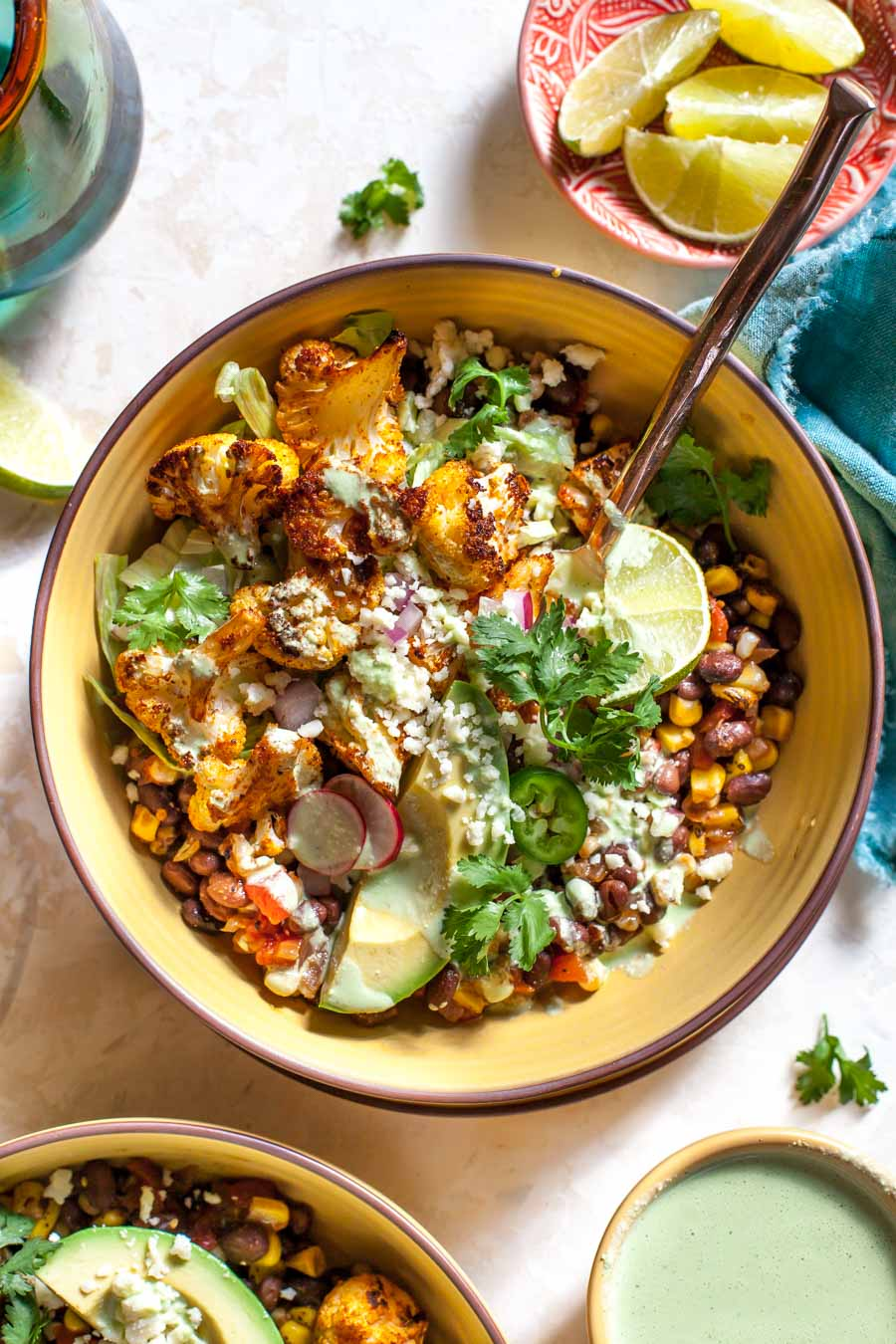 Roasted Cauliflower Burrito Bowls with chipotle-style black beans and Jalapeño Ranch