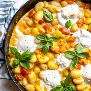 Gnocchi with Burst Tomatoes, Creamy Garlic Sauce, and Burrata Cheese