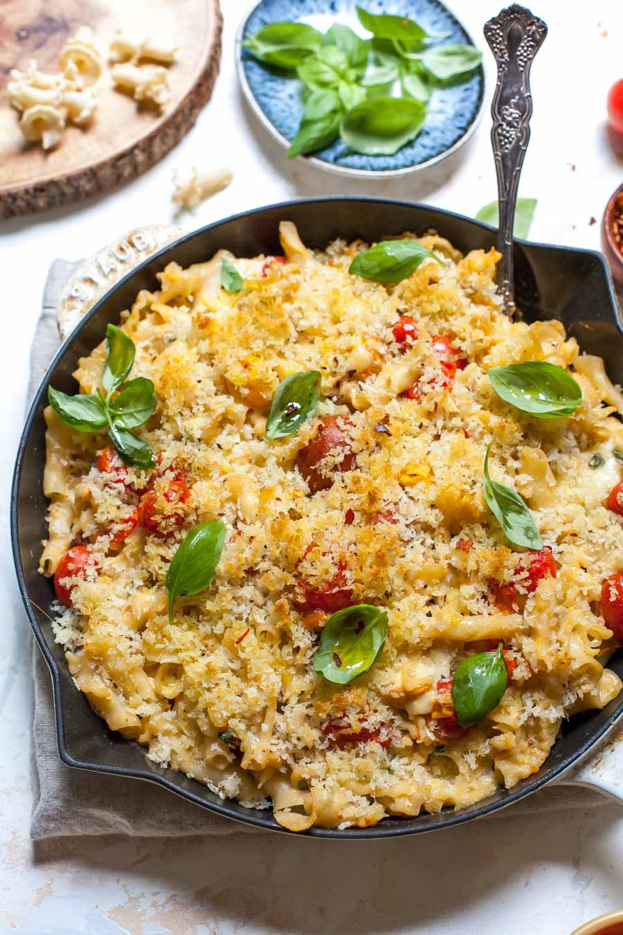 Mac and Cheese with burst tomatoes, garlic, basil, and a buttery panko topping