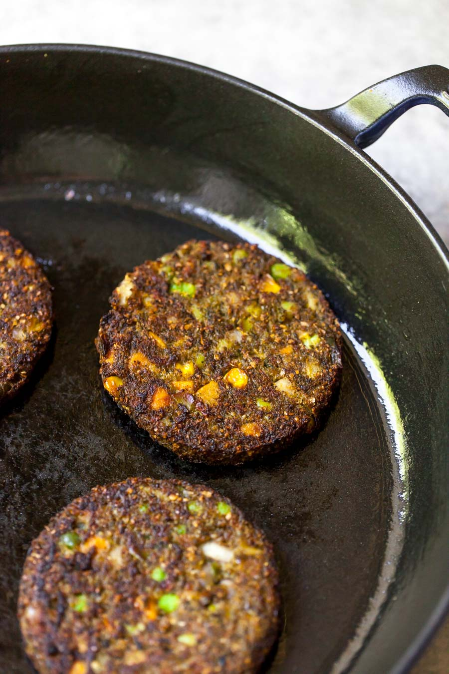 Dr. Praeger's Frozen Tex Mex Veggie Burgers cooked in a skillet