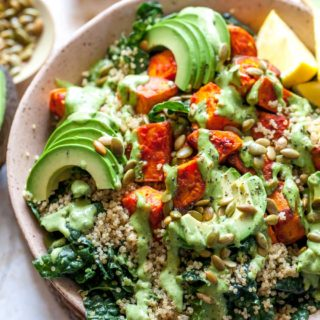 Kale Salad with Roasted Sweet Potatoes, Quinoa, and Parslied-Tahini Dressing
