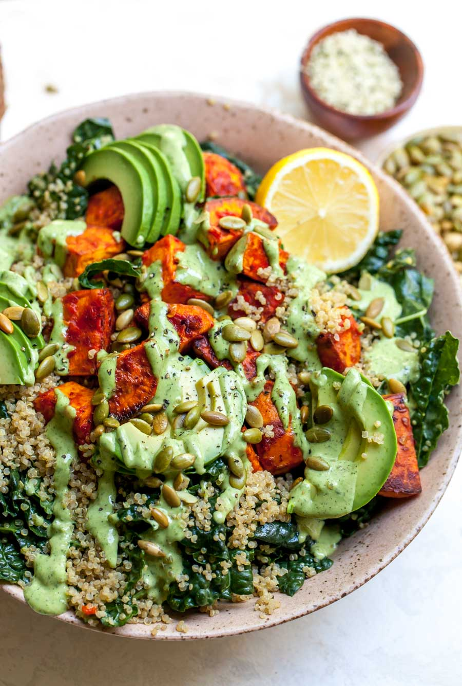 Meal Prep Kale and Quinoa Salad with Roasted Sweet Potatoes and Tahini Dressing