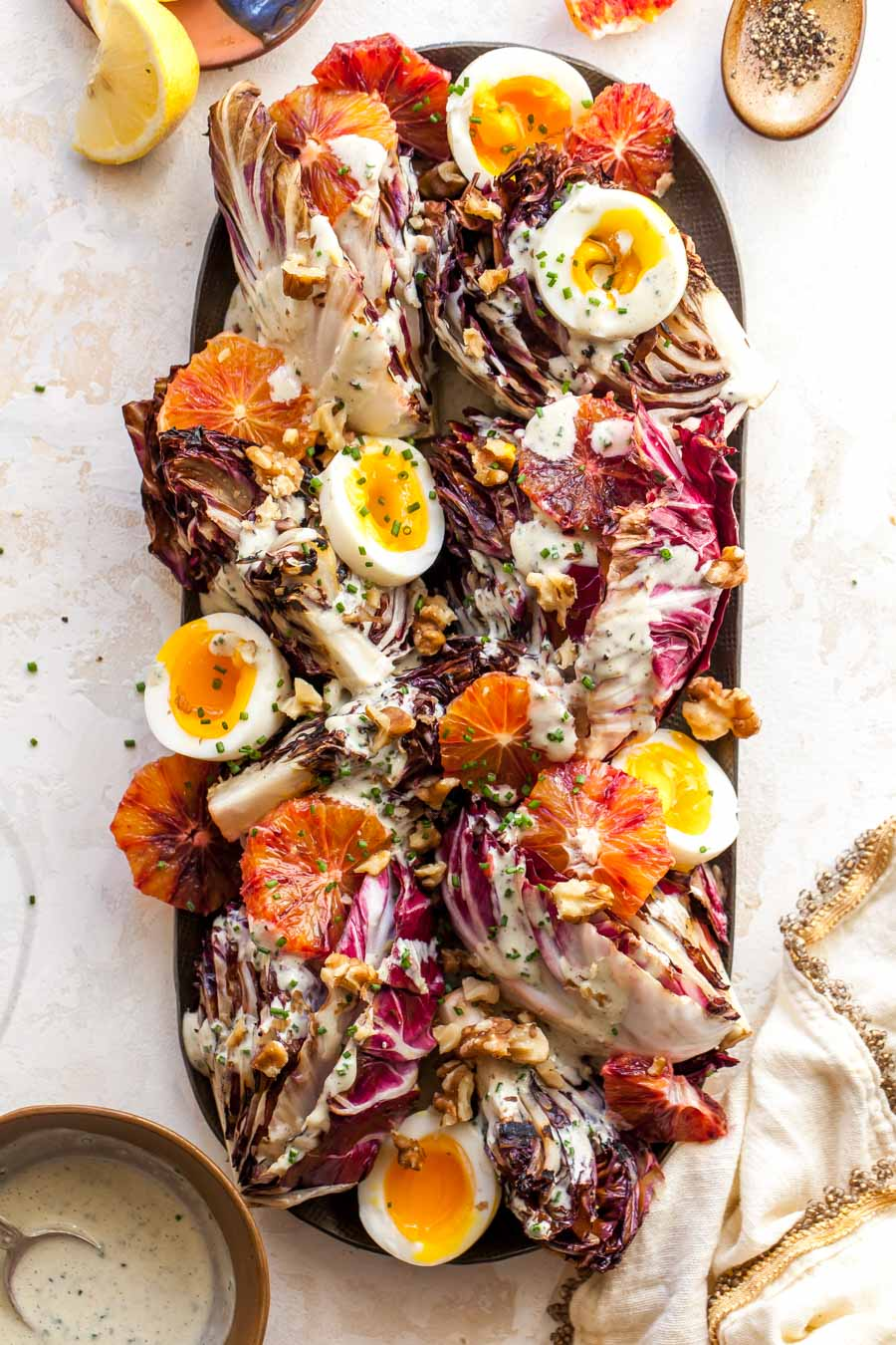 Radicchio Salad with Miso Dressing, soft boiled eggs, citrus, and walnuts.