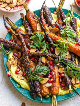 Curried Yogurt Topped with Baked Carrots, Almonds, and Pomegranate
