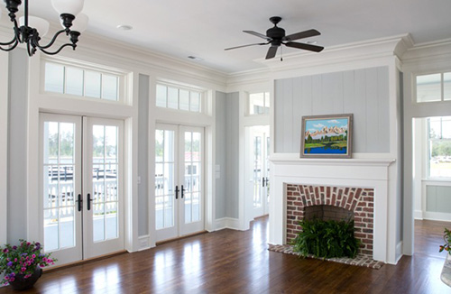 Great room with crown molding and fireplace