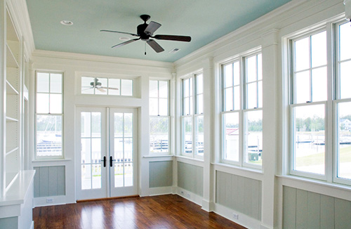 Porch with crown molding and wood floors