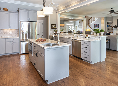 Open kitchen with stainless steel appliances and island