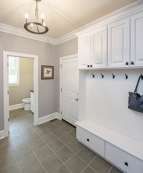 Mudroom with custom cabinets and 1/2 bath