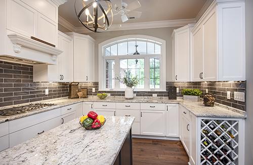 Kitchen with island, wine rack and palladium window
