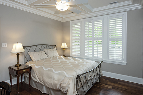 Bedroom with tray ceiling and crown molding