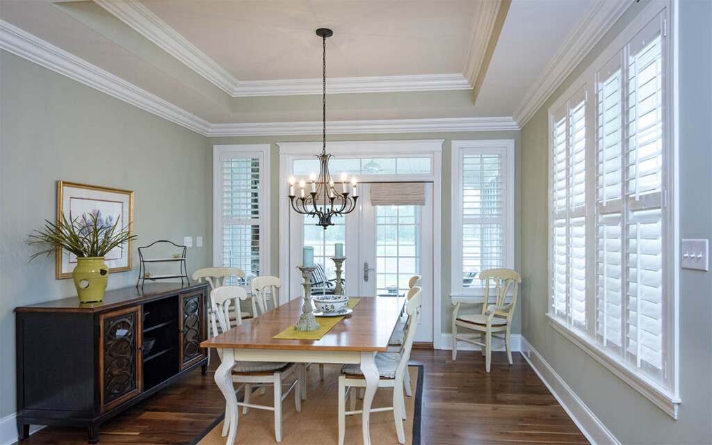Dining room with french doors and tray ceiling