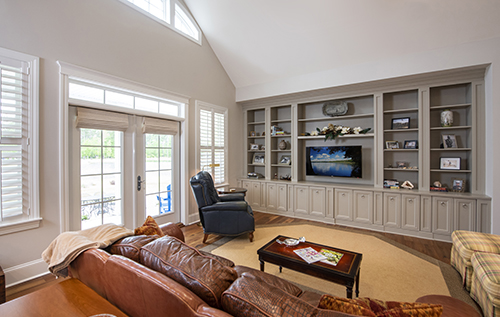 Great room with custom built in bookcase