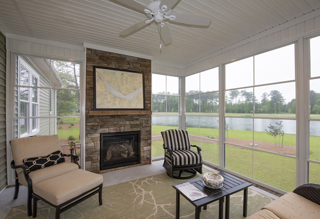 Screened in porch with stone fireplace