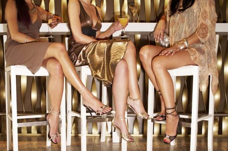 Ladies in High Heels Sitting at a Bar