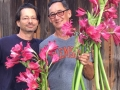 Jenks & Tom with a mix of red Crinum Lilies