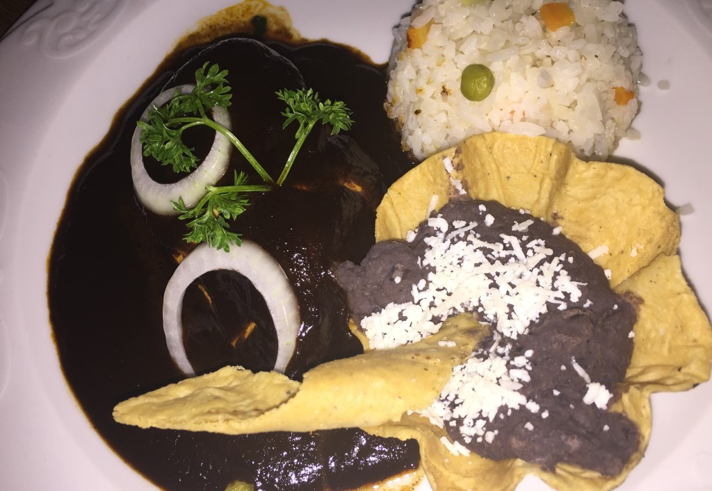 Chicken with black mole.