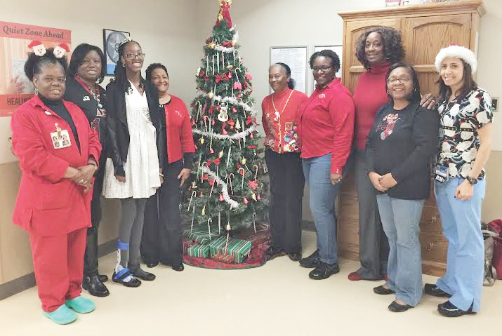 Local Delta members and Ms. Jabberwock 2015, Sydnee Evans (3rd from left) at the Neonatal Intensive Care Unit at Roanoke Memorial Hospital.