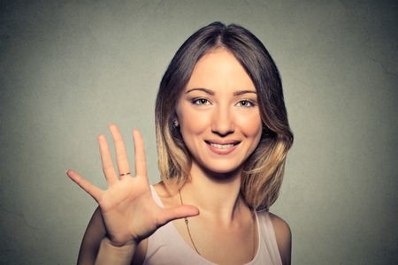 43705145 - smiling woman making high five with her hand