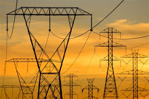Silhouette of power lines under sunset sky (Blend Images via AP Images)