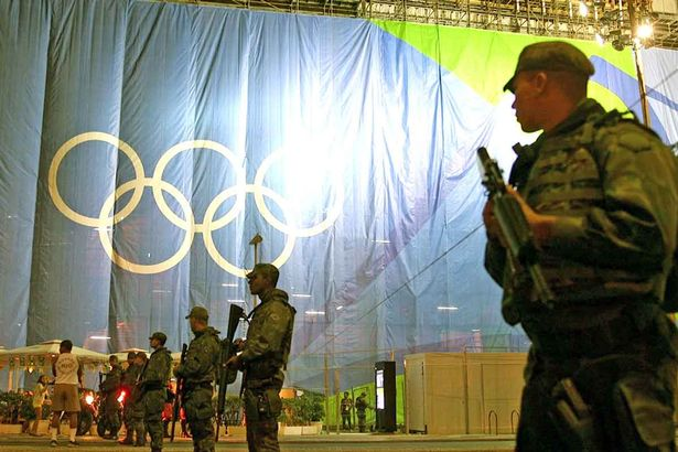 FEB05-Bomb-disposal-squad-cordon-off-an-area-outside-the-Beach-Volleyball-Arena