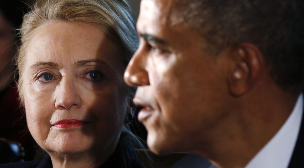 """U.S. Secretary of State Hillary Clinton (L) listens to U.S. President Barack Obama speak during a meeting with members of his cabinet at the White House in Washington November 28, 2012. Obama said on Wednesday he hopes he can reach agreement with the U.S. Congress before Christmas to avoid the looming """"fiscal cliff"""" and shrink the budget deficit, and urged supporters to pressure lawmakers via Twitter and other social media. REUTERS/Kevin Lamarque (UNITED STATES - Tags: POLITICS BUSINESS)"""