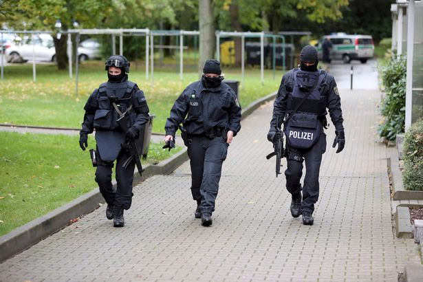 german-special-policemen-search-a-housing-area-in-the-eastern-city-of-chemnitz-on-suspicion-that-a-b
