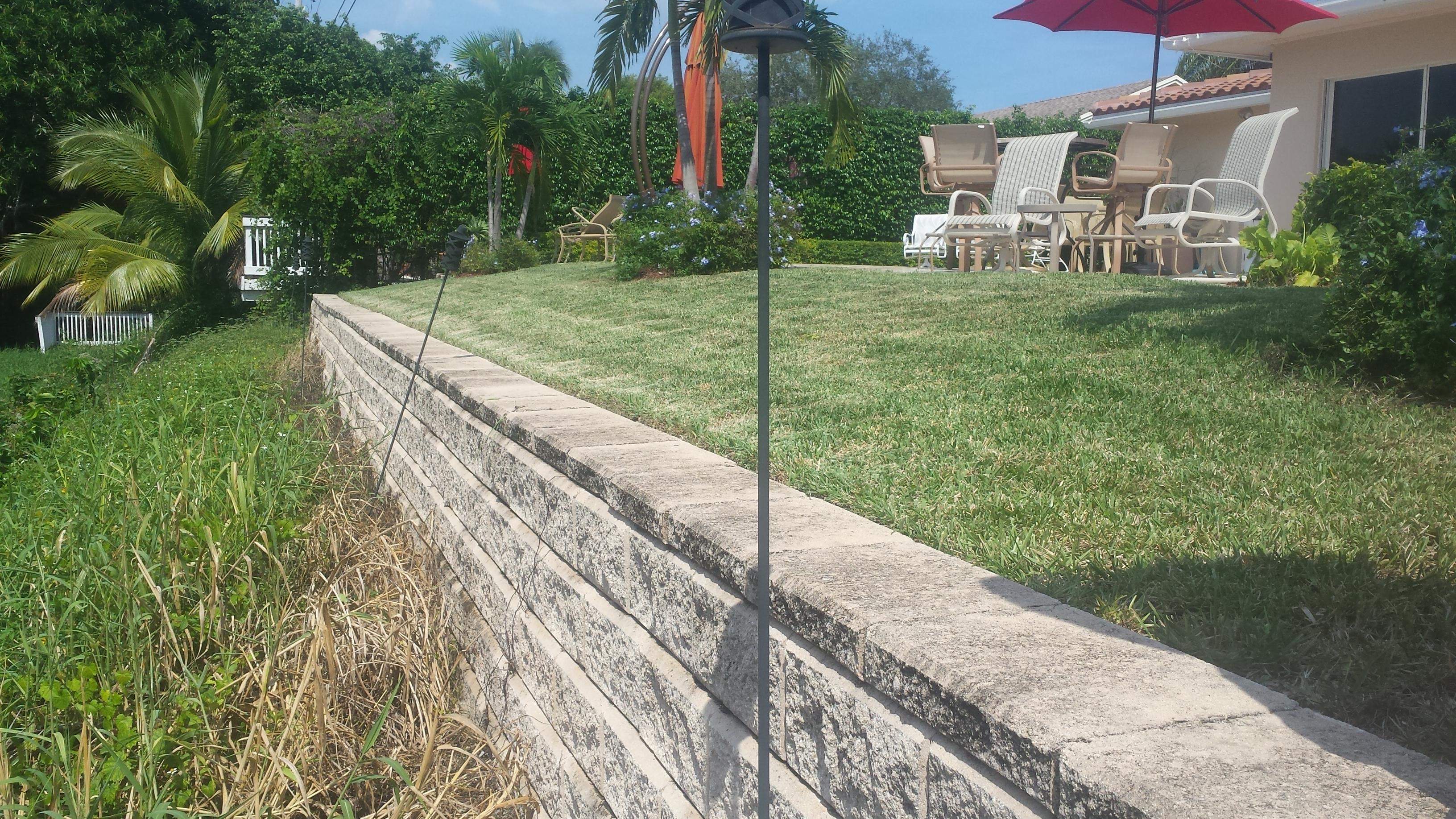 Retaining Block Wall Holding Property In Backyard Slope
