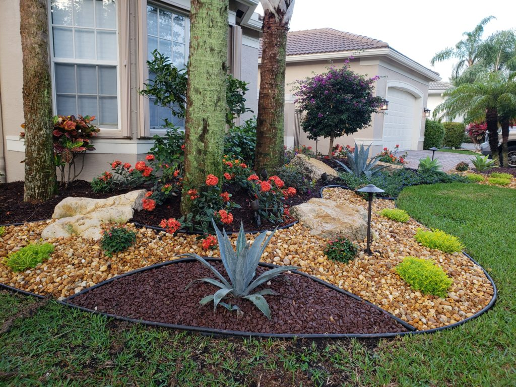 front yard landscape makeover with stone accents & new plantings