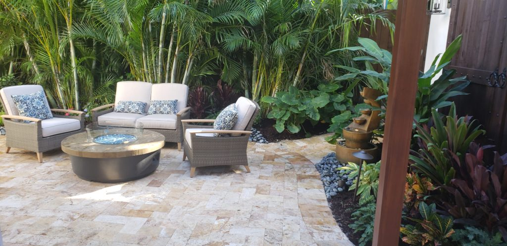 Paver patio firepit area in tropical garden