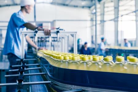 worker on a bottling line