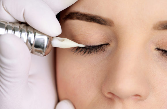 Cosmetologist making permanent makeup, close up