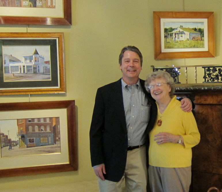 Robert Morrissey, owner of Clark Graves Antiques in Clayton, with Carlene Masters during a show there of Stan's paintings.