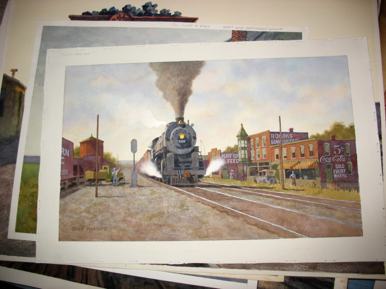 """A stack of Stan's paintings with """"Noon Freight"""" on top."""