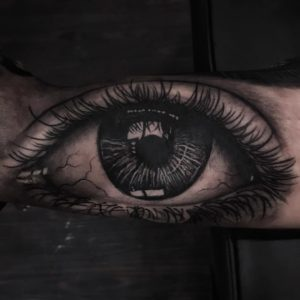 Black and grey eye tattoo by Turah Ink - Notorious Ink Bali