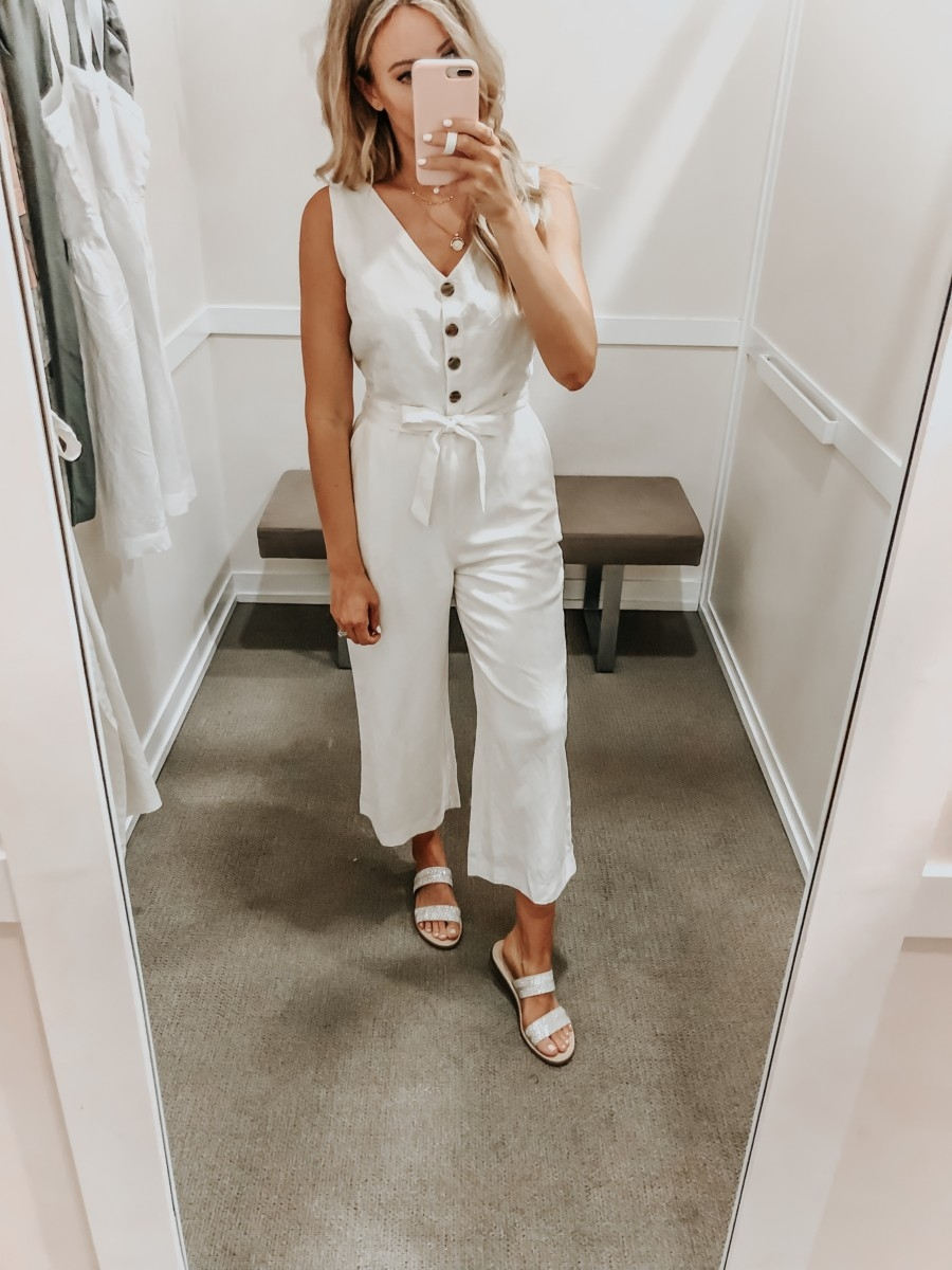 Best Memorial Day Weekend Sales featured by top US fashion blog Haute & Humid; Image of a woman wearing LOFT white jumpsuit.