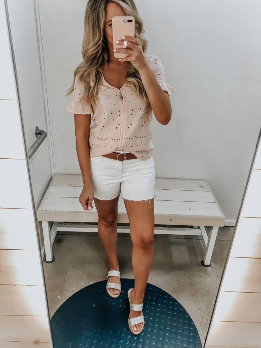Best Memorial Day Weekend Sales featured by top US fashion blog Haute & Humid; Image of a woman wearing Old Navy white denim shorts and Old Navy eyelet top.
